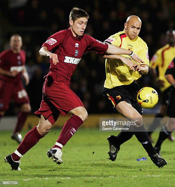Gavin Mahon of Watford fights for the ball with Chris McPhee of Brighton Hove Albion during the CocaCola Championship match between Watford and...