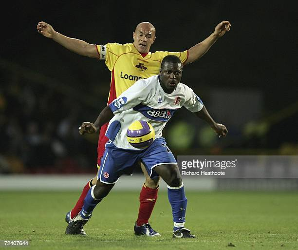 Gavin Mahon of Watford is held off by Aiyegbeni Yakubu of Boro during the Barclays Premiership match between Watford and Middlesbrough at Vicarage...