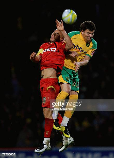 Gavin Mahon of Watford jumps with Chris Martin of Norwich during the CocaCola Championship match between Norwich City and Watford at Carrow Road on...