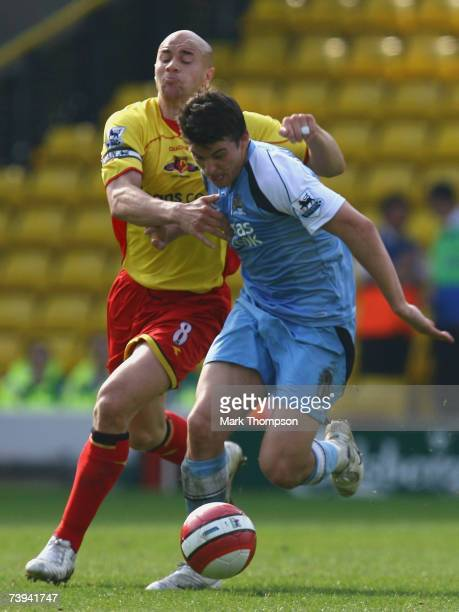 LONDON APRIL 21 Gavin Mahon of Watford tangles with Joey Barton of Manchester City during the Barclays Premiership match between Watford and...