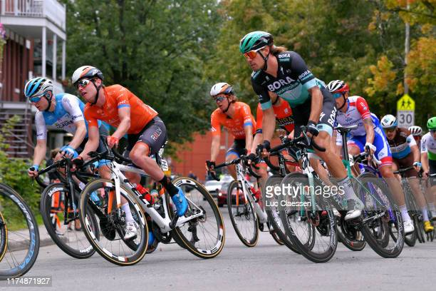 Gavin Mannion of The United States and Team Rally UHC Cycling / Daniel Oss of Italy and TeamTeam Bora - Hansgrohe / during the 10th Grand Prix...