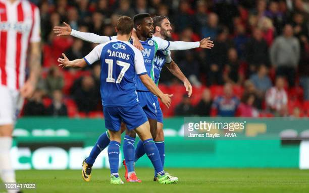 Gavin Massey of Wigan Athletic celebrates with his team mates after scoring a goal to make it 02 during the Sky Bet Championship match between Stoke...