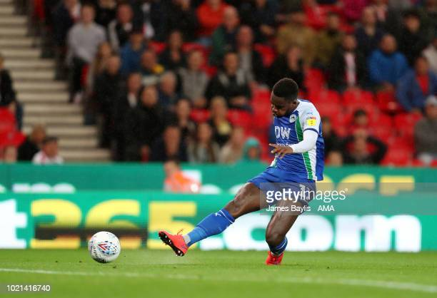 Gavin Massey of Wigan Athletic scores a goal to make it 02 during the Sky Bet Championship match between Stoke City and Wigan Athletic at Bet365...