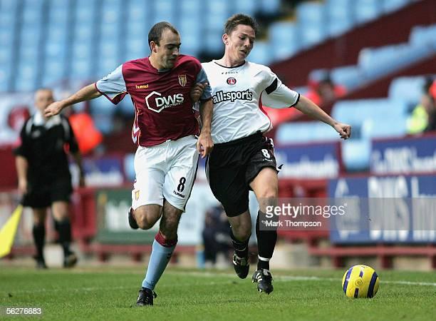 Gavin McCann of Aston Villa tangles with Matt Holland of Charlton during the Barclays Premiership match between Aston Villa and Charlton Athletic on...