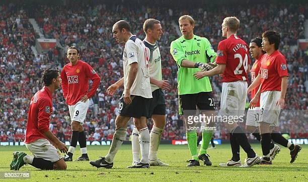 Gavin McCann of Bolton Wanderers complains to Cristiano Ronaldo of Manchester United after Ronaldo won a penalty during the FA Premier League match...