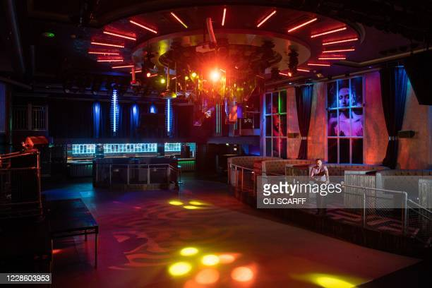 Gavin McQueen, the General Manager of Leeds PRYZM nightclub, poses for a photograph inside his nightclub in Leeds, central England on September 18 as...