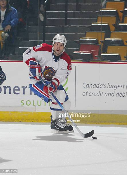 Gavin Morgan of the Hamilton Bulldogs looks to make a play from the wing during the American Hockey League game against the Edmonton Road Runners at...