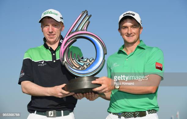 Gavin Moynihan of Ireland and Paul Dunne of Ireland with the winners trophy after the final of the Golf Sixes at The Centurion Club on May 6 2018 in...
