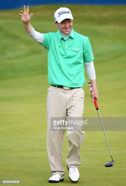Gavin Moynihan of Ireland celebrates a birdie on the 18th green during day one of the Dubai Duty Free Irish Open at Portstewart Golf Club on July 6...