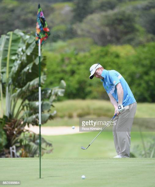Gavin Moynihan of Ireland chips onto the 17th during day one of the AfrAsia Bank Mauritius Open at Heritage Golf Club on November 30 2017 in Bel...