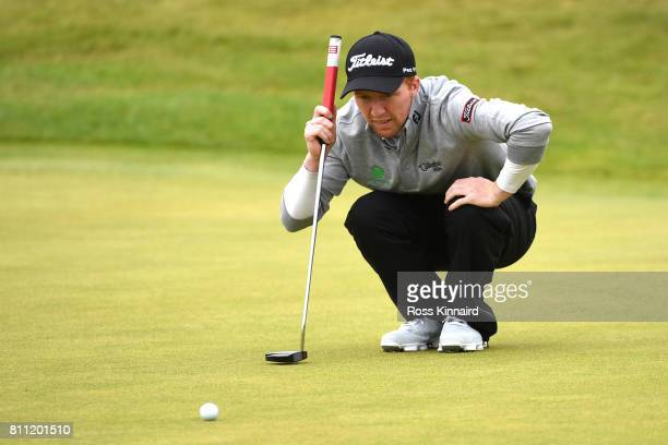 Gavin Moynihan of Ireland lines up a putt on the 18th green during the final round of the Dubai Duty Free Irish Open at Portstewart Golf Club on July...