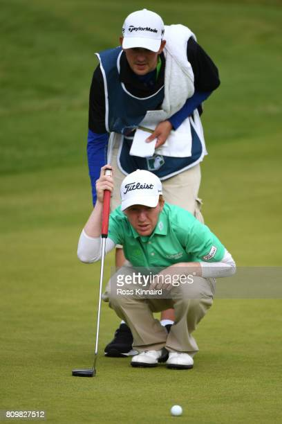Gavin Moynihan of Ireland lines up on the 18th green during day one of the Dubai Duty Free Irish Open at Portstewart Golf Club on July 6 2017 in...