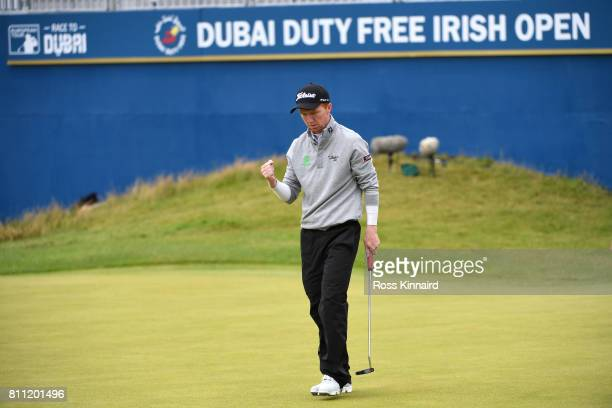 Gavin Moynihan of Ireland reacts to a putt on the 18th green during the final round of the Dubai Duty Free Irish Open at Portstewart Golf Club on...