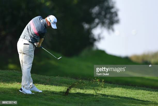 Gavin Moynihan of Ireland takes a shot from the 1st fairway on Day Two of the NBO Golf Classic Grand Final European Challenge Tour at Al Mouj Golf on...