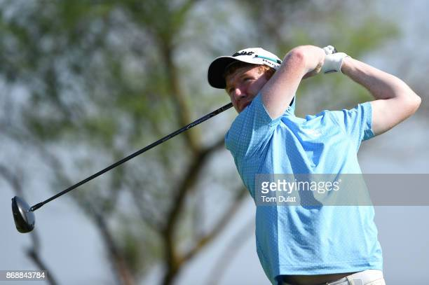 Gavin Moynihan of Ireland tees off on the 1st hole during day one of the NBO Golf Classic Grand Final at Al Mouj Golf on November 1 2017 in Muscat...