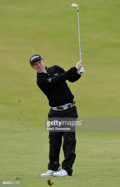 Gavin Moynihan of Northern Ireland plays his second shot to the 1st hole during the final day of the 2017 SSE Scottish Hydro Challenge hosted by...