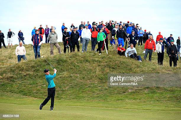 Gavin Moynihan of the Great Britain and Ireland team plays his second shot on the 8th hole in his match with Jack Hume against Bryson DeChambeau and...