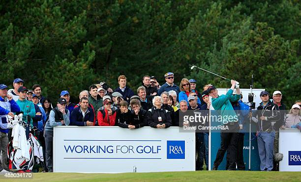 Gavin Moynihan of the Great Britain and Ireland team plays his tee shot on the 9th hole in his match with Jack Hume against Bryson DeChambeau and...