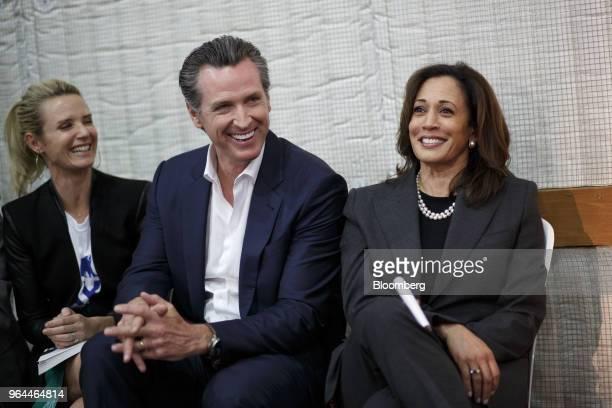 Gavin Newsom Democratic candidate for governor of California center smiles next to his wife Jennifer Newsom left and Senator Kamala Harris a Democrat...