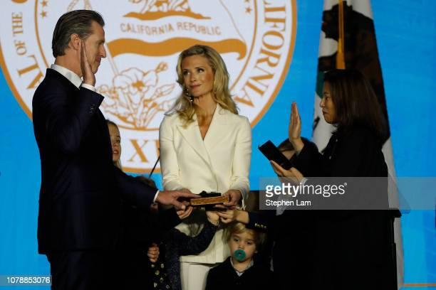 Gavin Newsom is sworn in as governor of California by California Chief Justice Tani Gorre CantilSakauye as Newsom's wife Jennifer Siebel Newsom...