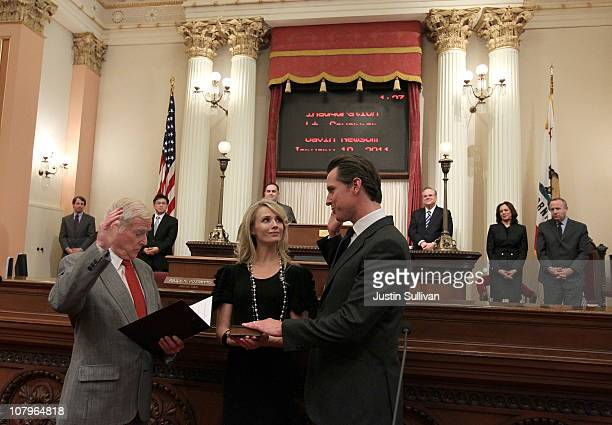 Gavin Newsom is sworn in as the 49th Lt Governor of California by his father William A Newsom as his wife Jennifer SiebelNewsom looks on at the...