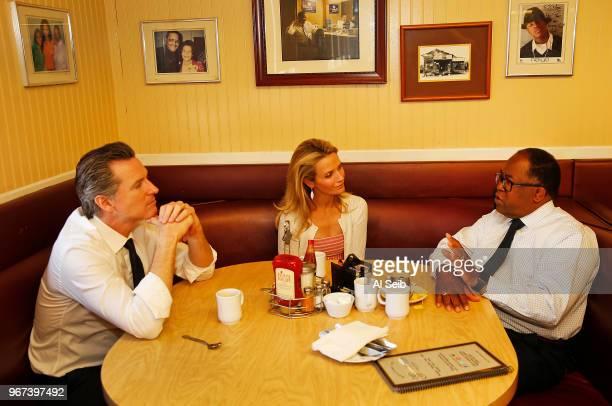 Gavin Newsom with his wife Jennifer Siebel Newsom left meet with LA County Supervisor Mark RidleyThomas for breakfast at The Serving Spoon Restaurant...