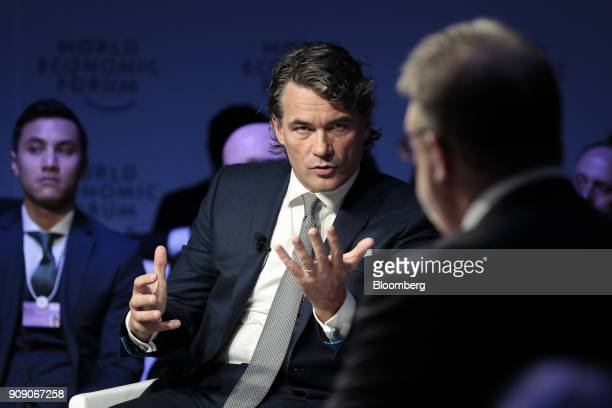 Gavin Patterson chief executive officer of BT Group Plc gestures while speaking on a panel session on the opening day of the World Economic Forum in...