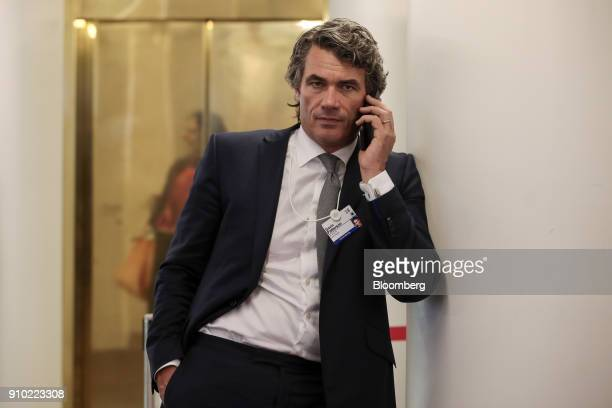 Gavin Patterson chief executive officer of BT Group Plc speaks on a mobile phone on day three of the World Economic Forum in Davos Switzerland on...