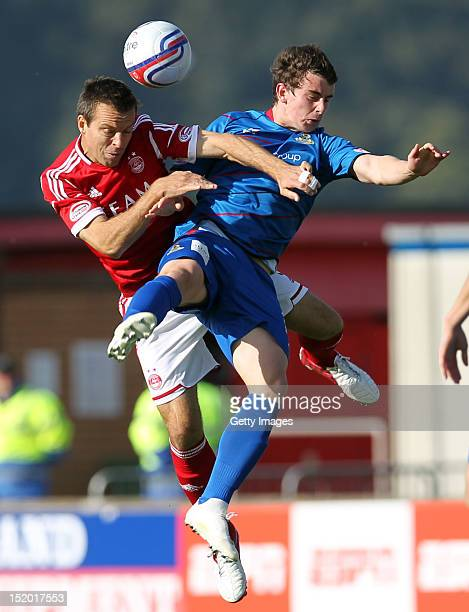 Gavin Rae of Aberdeen competes with Aaron Doran of Inverness Caledonian Thistle during the Clydesdale Bank Scottish Premier League match on September...