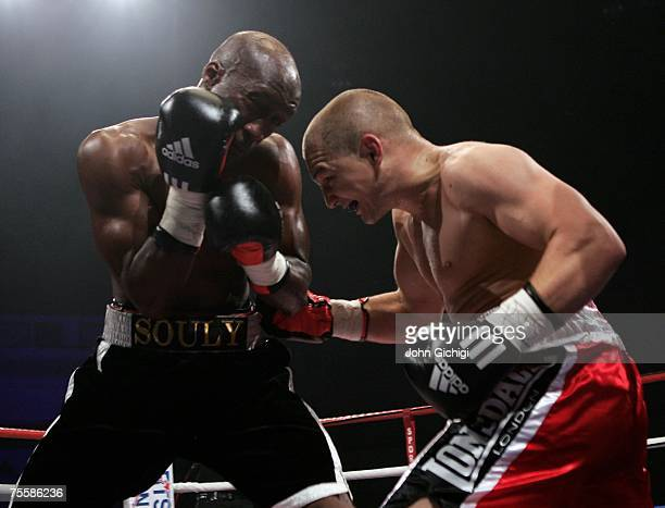 Gavin Rees connects to the body against Souleymane M'baye during the WBA Light Welterweight title fight at the Cardiff International Arena July 21...