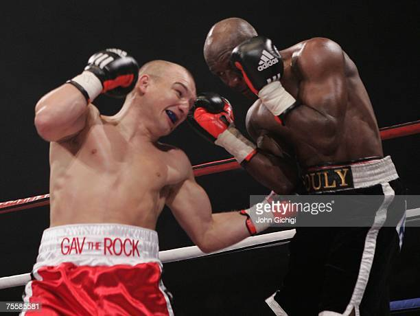 Gavin Rees connects with a body shot against Souleymane M'baye during the WBA Light Welterweight title fight on July 21 2007 at the Cardiff...