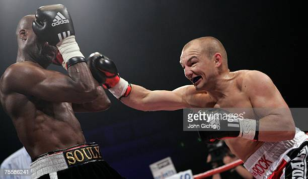 Gavin Rees hits Souleymane M'baye during the WBA Light Welterweight title fight at the Cardiff International Arena July 21 2007 in Cardiff Wales