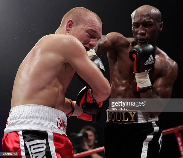 Gavin Rees is hit by Souleymane M'baye during the WBA Light Welterweight title fight at the Cardiff International Arena July 21 2007 in Cardiff Wales