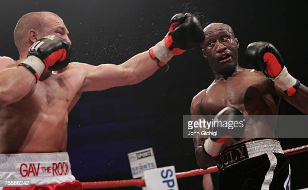 Gavin Rees misses with a left hook against Souleymane M'baye during the WBA Light Welterweight title fight at the Cardiff International Arena July 21...