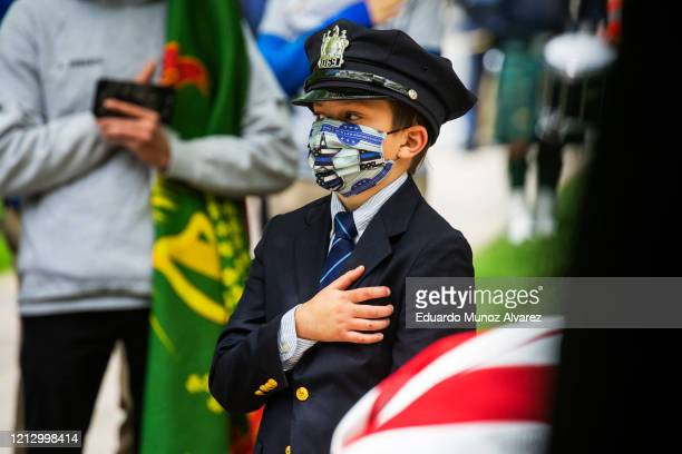 Gavin Roberts son of Glen Ridge Police Officer Charles Roberts wears his father's hat during his funeral after he passed away from the coronavirus on...