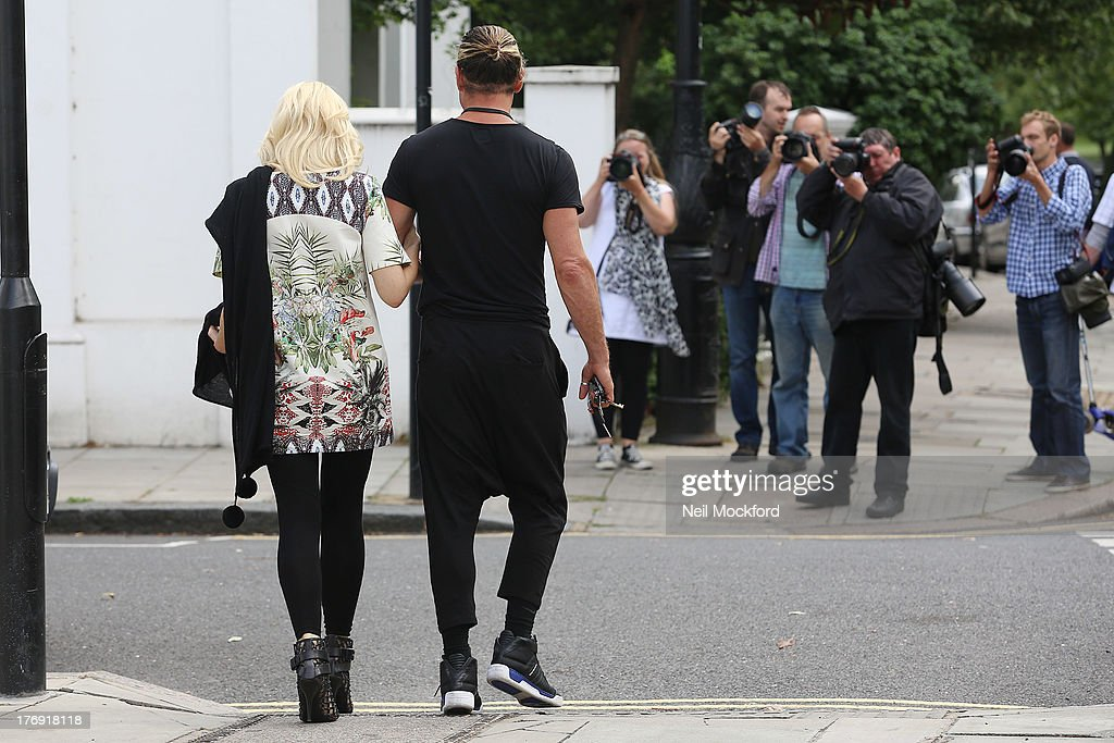 Gavin Rossdale and Gwen Stefani are photographed by photographers in Primrose Hill after having lunch together on August 19, 2013 in London, England.