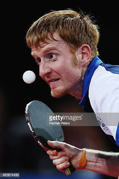 Gavin Rumgay of Scotland serves against Rohan Sirisena of Sri Lanka during the Men's Teams first round table tennis match between Scotland and Sri...