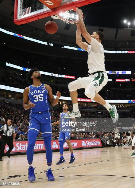 Gavin Schilling of the Michigan State Spartans dunks over Marvin Bagley III of the Duke Blue Devils during the State Farm Champions Classic at the...