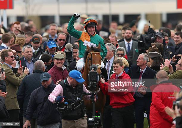 Gavin Sheehan on Cole Harden celebrates after winning the Ladbrokes World Hurdle during St Patrick's Thursday at the Cheltenham Festival at...