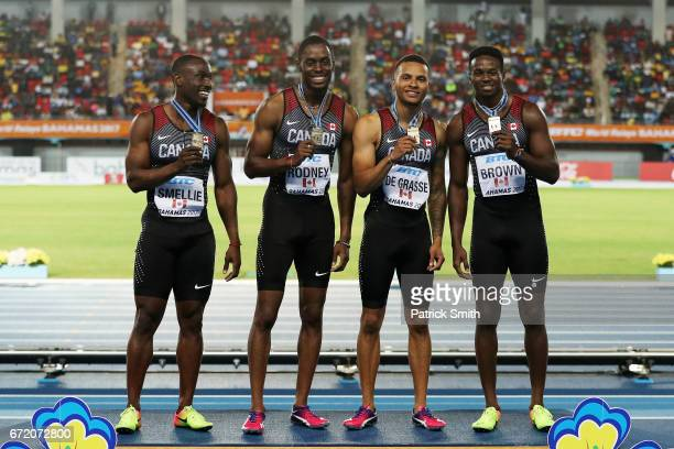 Gavin Smellie Brendon Rodney Andre De Grasse and Aaron Brown celebrate on the podium after placing first in the Men's 4x200 Metres Relay Final during...