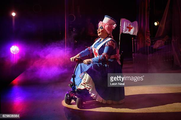Gavin Spokes makes his grand entrance on a mobility scooter during a performance of the traditional pantomime 'Sleeping Beauty' at the Hackney Empire...