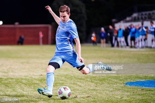 Gavin Tasker of Tufts Jumbos crosses the ball during the Division III Men's Soccer Championship held at UNCG Soccer Stadium on December 7 2019 in...