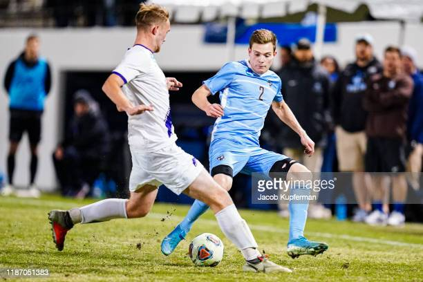 Gavin Tasker of Tufts Jumbos tries to get past Kyle Kelly of Amherst Mammoths during the Division III Men's Soccer Championship held at UNCG Soccer...