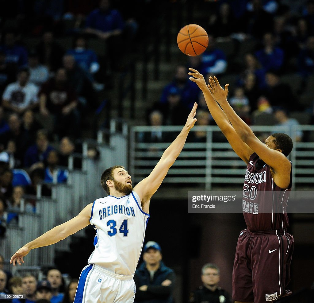Gavin Thurman #20 of the Missouri State Bears shoots over Ethan Wragge #34 of the Creighton Bluejays during their game at the CenturyLink Center on January 30, 2013 in Omaha, Nebraska.