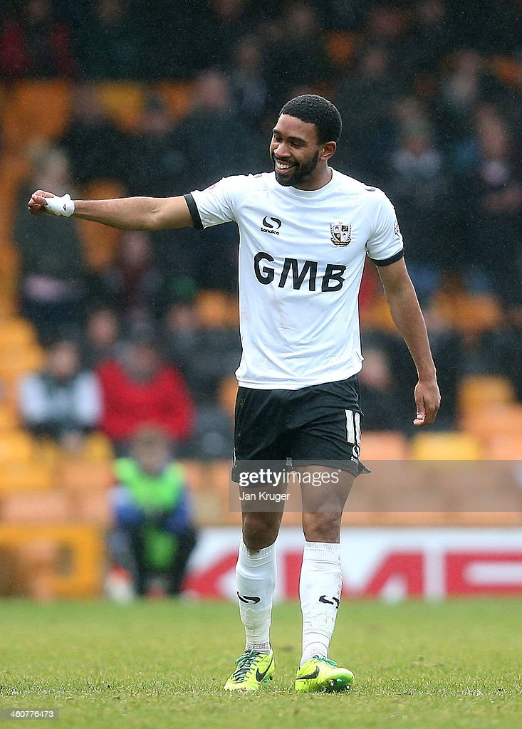 Gavin Tomlin of Port Vale celebrates after scoring the opening goal during the Budweiser FA Cup third round match between Port Vale and Plymouth Argyle at Vale Park on January 5, 2014 in Burslem, England.