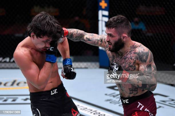 Gavin Tucker of Canada punches Billy Quarantillo in their featherweight bout during the UFC 256 event at UFC APEX on December 12, 2020 in Las Vegas,...