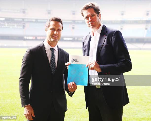 Gavin Wanganeen presents a report to AFL CEO Gillon McLachlan during an Indigenous Past Player Group announcement at Etihad Stadium on June 28 2018...