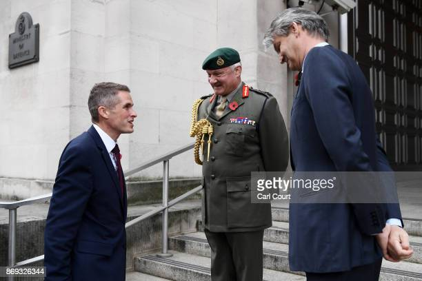 Gavin Williamson is greeted by Vice Chief of the Defence Staff Gordon Messenger and Permanent Secretary at the Ministry of Defence Stephen Lovegrove...