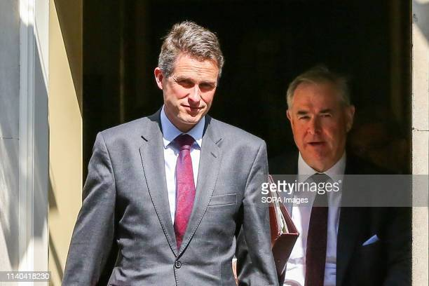 Gavin Williamson Secretary of State for Defence and Geoffrey Cox Attorney General are seen departing from No 10 Downing Street after attending the...