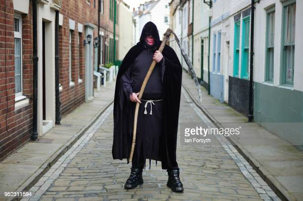 Gavin Woodward from Newcastle poses dressed as the Grim Reaper as he attends Whitby Gothic Weekend on April 28, 2018 in Whitby, England. The Whitby...